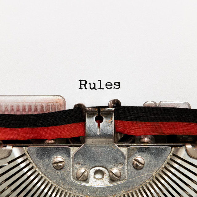 """Rules title text written on paper with typewriter"" stock image"