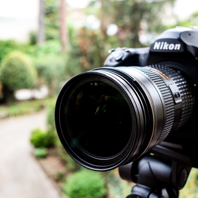 """Nikon D850 camera front view focus on lens professional photogra"" stock image"
