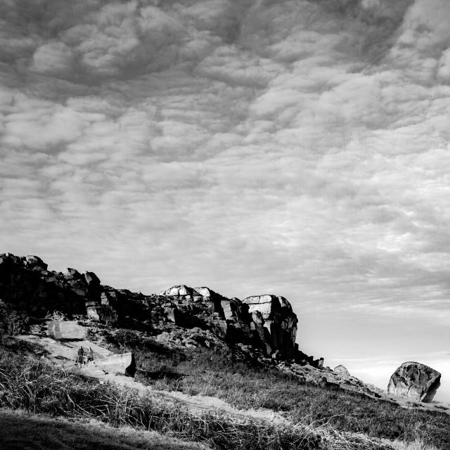 """Cow and Calf Rocks, Ilkley Moor in Early Morning Mist. Monochrome."" stock image"