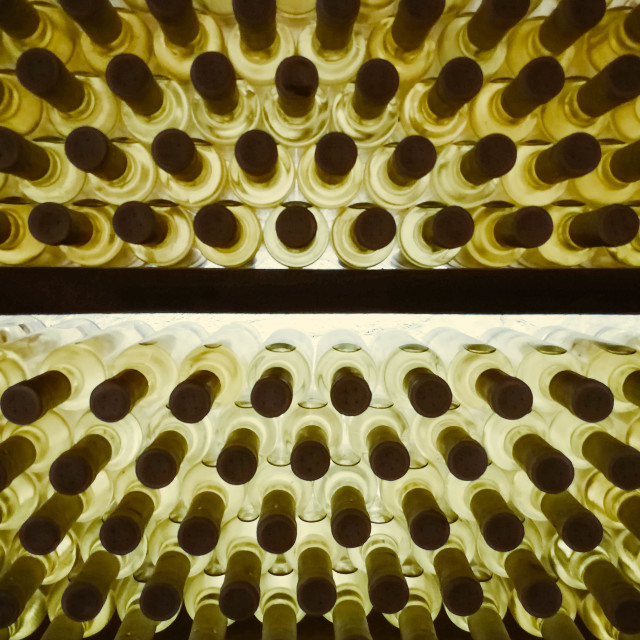 """""""Wine bottles stacked in a wine shelf - stock photo"""" stock image"""