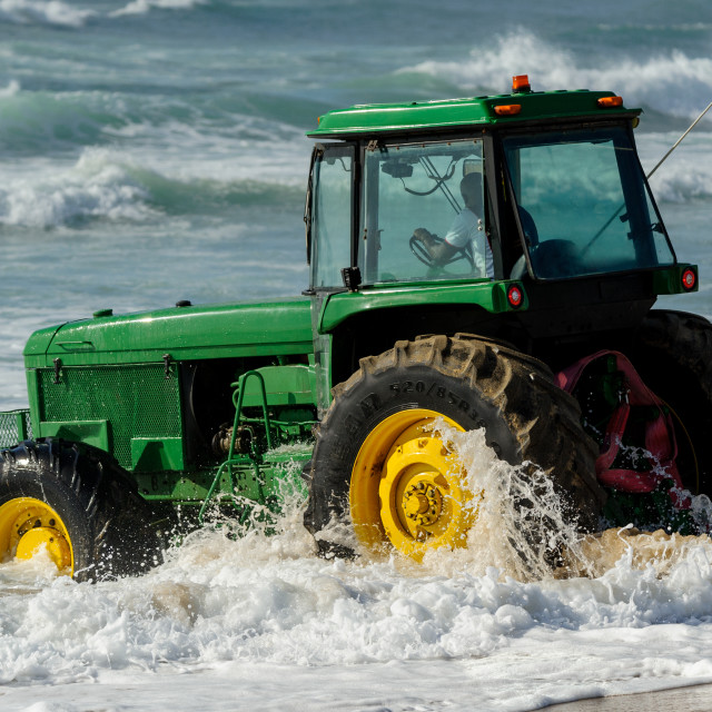 """""""Green Tractor In Surf"""" stock image"""