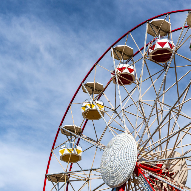 """""""Ferris wheel on right with clouds"""" stock image"""