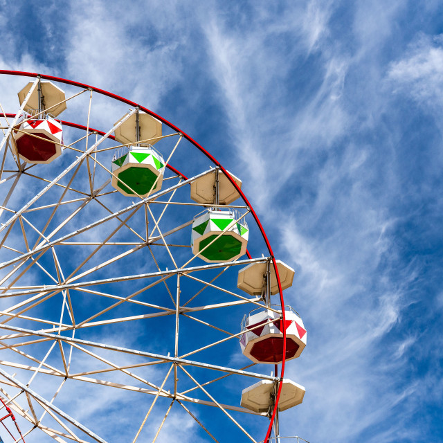 """""""Ferris wheel on left with clouds"""" stock image"""