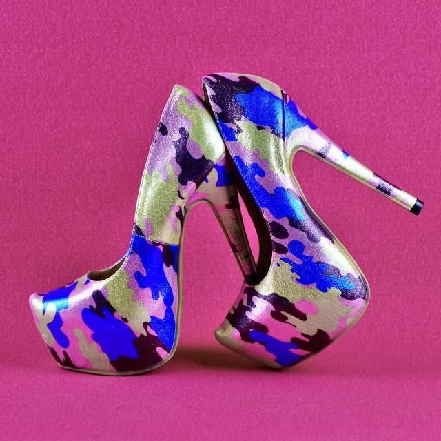"""Multi Coloured Stilettos On Pink"" stock image"