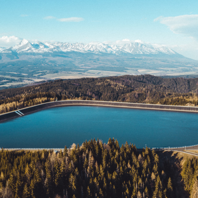 """""""Aerial view of Pumped Storage Power Plant with beautiful mountains in the background"""" stock image"""