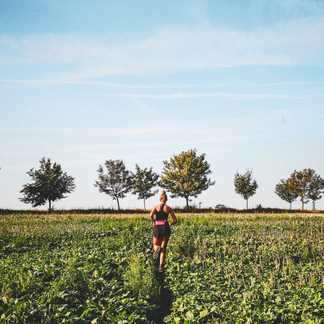 """""""Girl running in a field"""" stock image"""