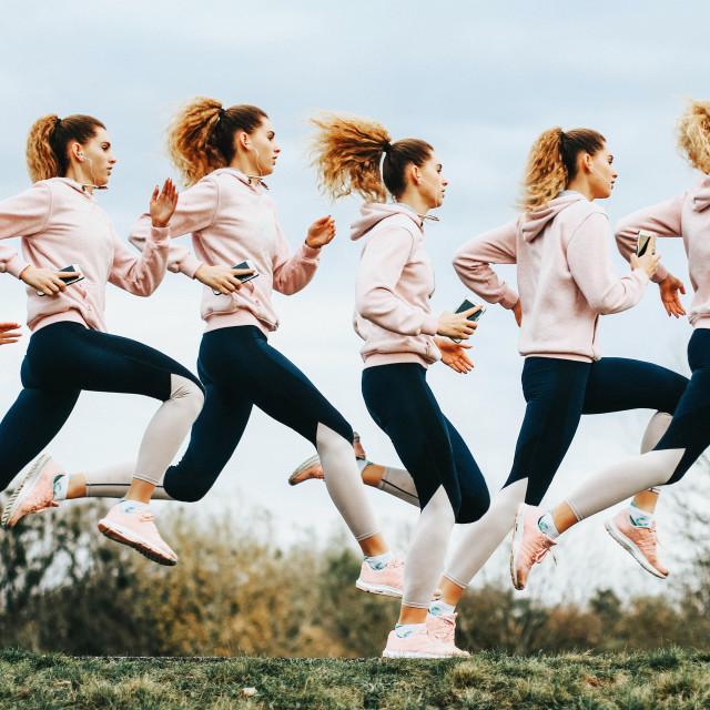 """Female runner sequence photo - multiple exposure"" stock image"