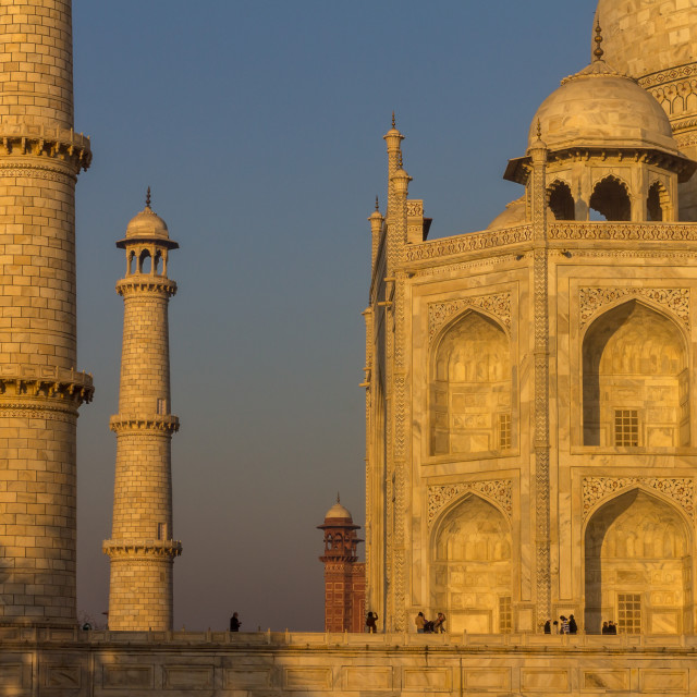 """Taj Mahal: minaret and a part of the façade in the golden rays"" stock image"