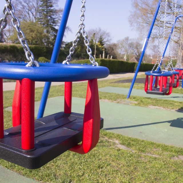 """Empty swings in children's playground during lockdown"" stock image"