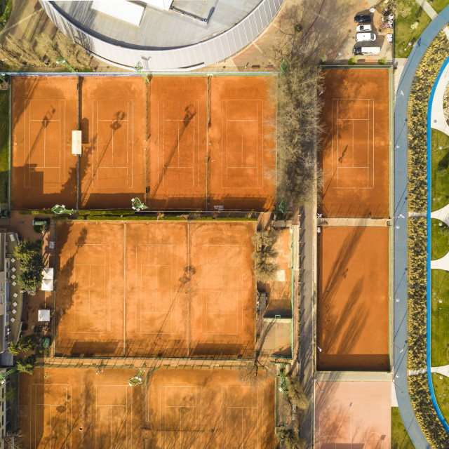 """""""Aerial view of an ellipse shaped public park, tennis courts and buildings"""" stock image"""