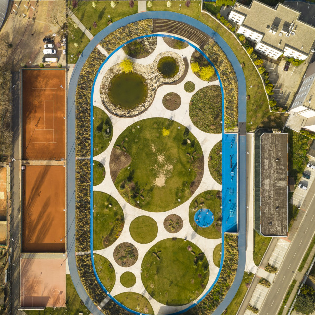 """""""Aerial view of an ellipse shaped public park, tennis courts and swimming pool"""" stock image"""