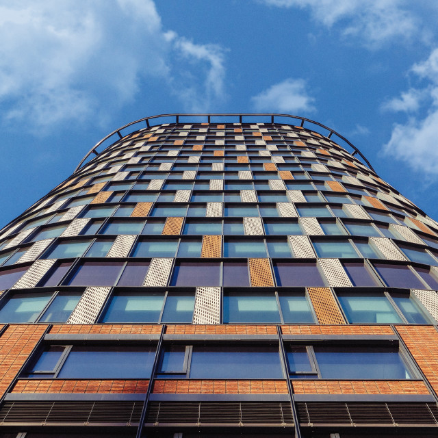 """""""Low angle view of a skyscraper office building with rectangular brick pattern"""" stock image"""
