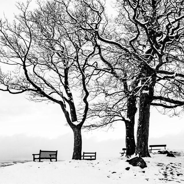 """""""Seats on Ilkley Moor Overlooking Ilkley. A Winter Scene."""" stock image"""