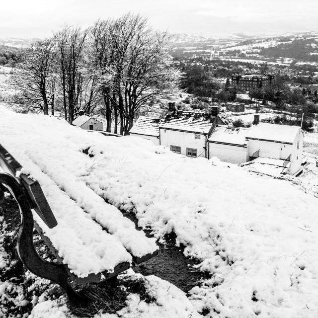 """Seat on Ilkley Moor Overlooking White Wells and Ilkley. A Winter Scene."" stock image"