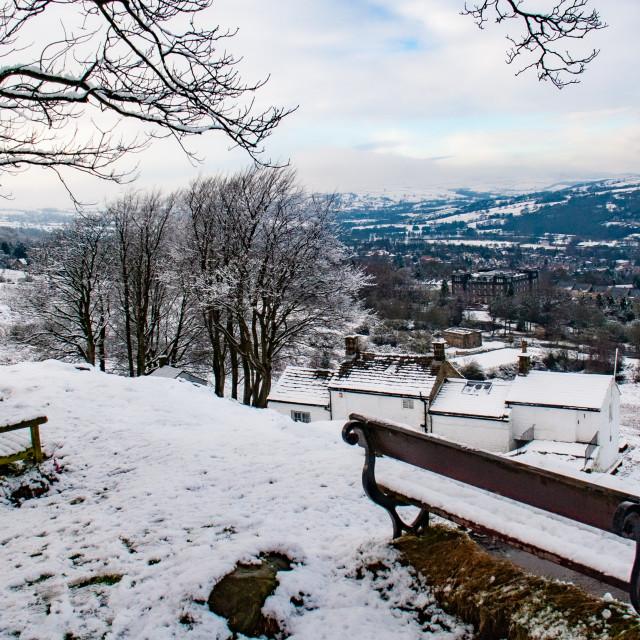 """Seats on Ilkley Moor Overlooking White Wells and Ilkley. A Winter Scene."" stock image"