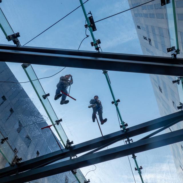 """""""Men at work, RIBA, Royal Albert Dock, Liverpool"""" stock image"""