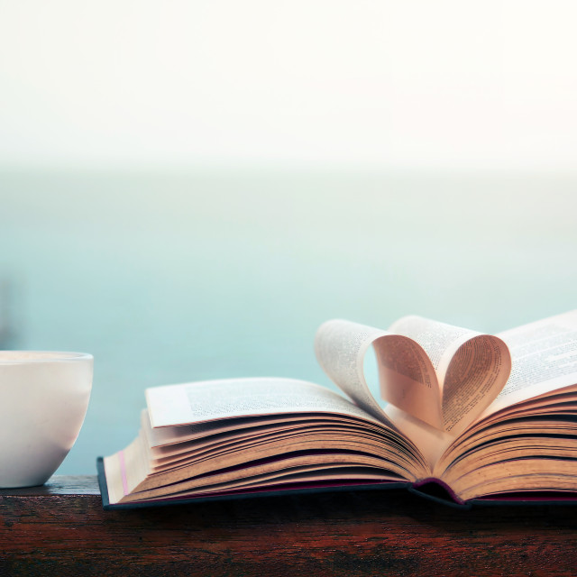 """""""Book and coffee time by the seaside"""" stock image"""