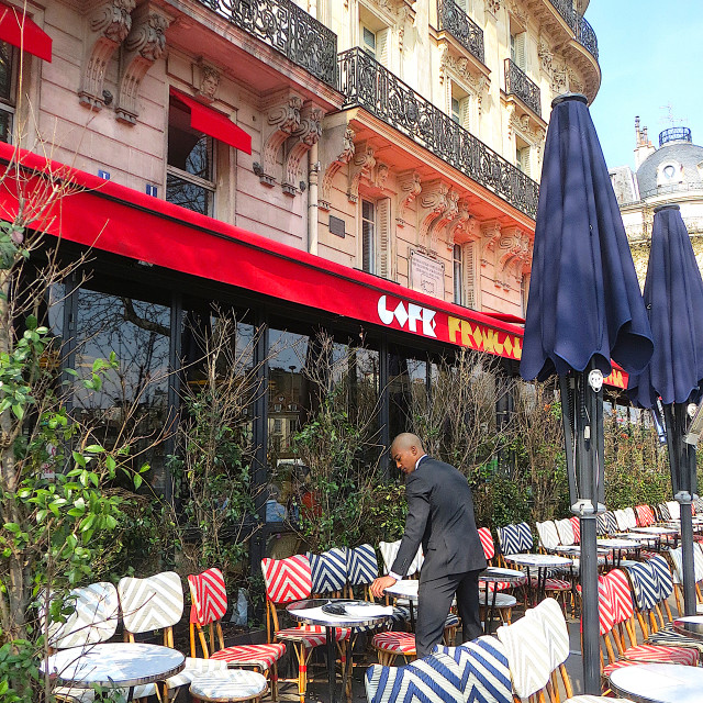 """Waiter at the terrace of a Parisian cafe"" stock image"