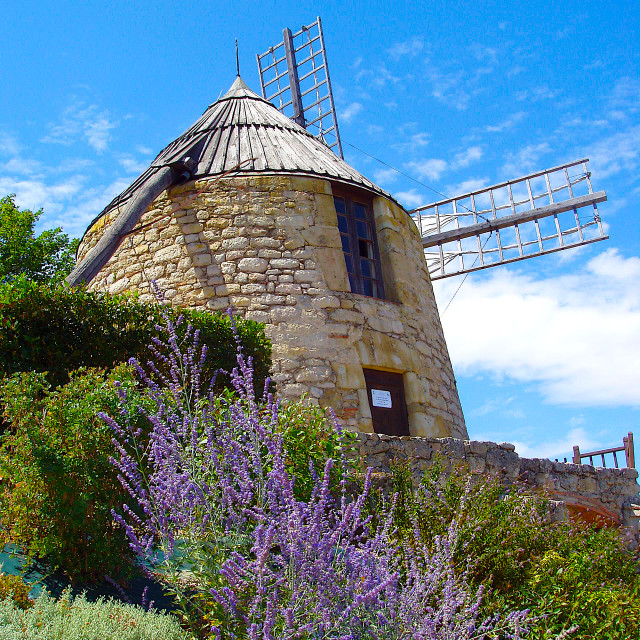 """Ancient windmill in Lautrec"" stock image"