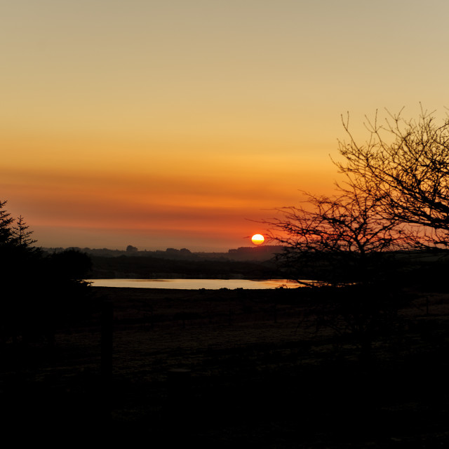 """""""Sunset over Stannon Lake, Bodmin Moor, Cornwall"""" stock image"""