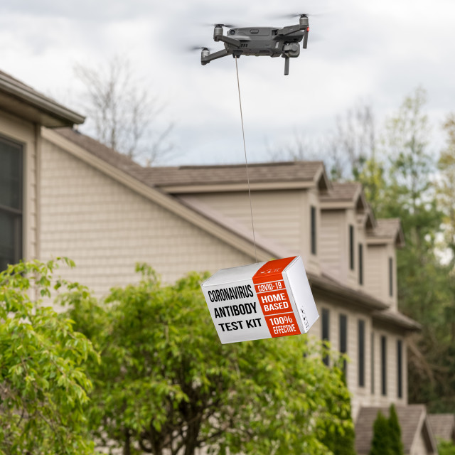 """""""Drone delivering a coronavirus home test kit to residential house"""" stock image"""
