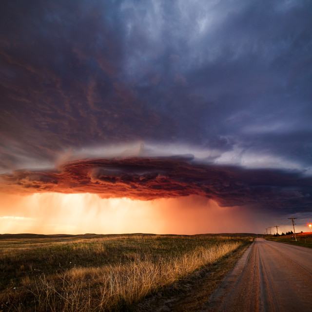 """A supercell thunderstorm at sunset in the sand hills near North Platte, Nebraska."" stock image"