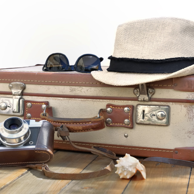 """""""retro suitcase and cameron punt on a wooden table with straw hat"""" stock image"""