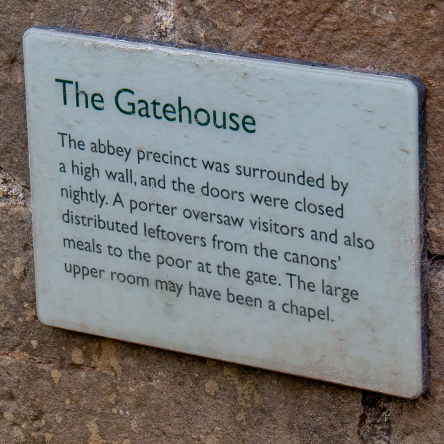 """""""Sign Details to Ruins of The Gatehouse, Easby Abbey, Richmond, Yorkshire."""" stock image"""