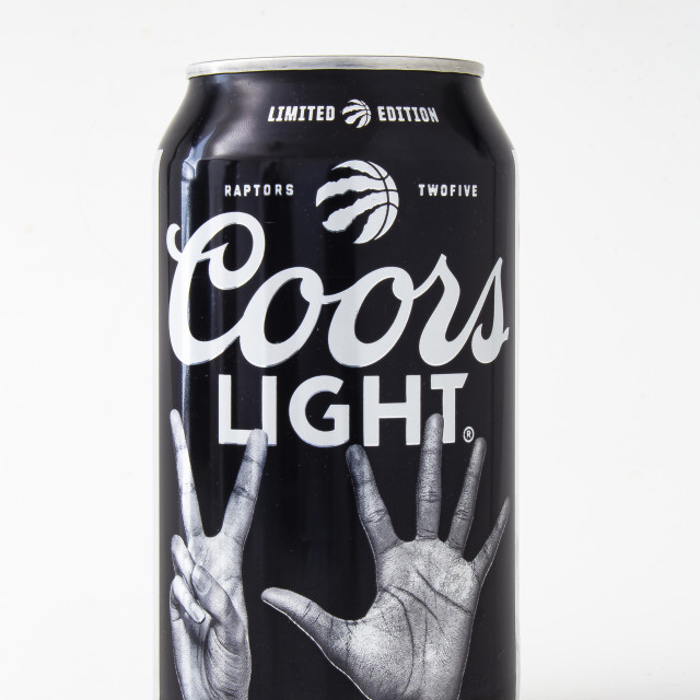 """A beer can of Coors Light special edition black can raptors, on a white background"" stock image"