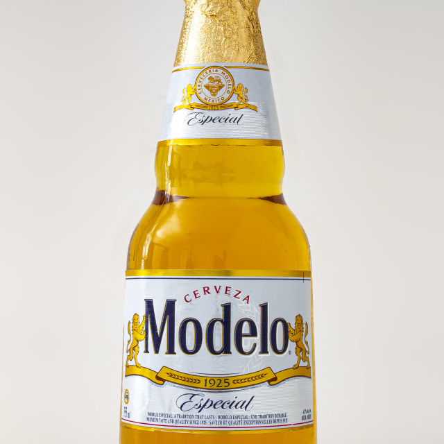 """Modelo Especial beer bottle clear bright yellow colour on a white background"" stock image"