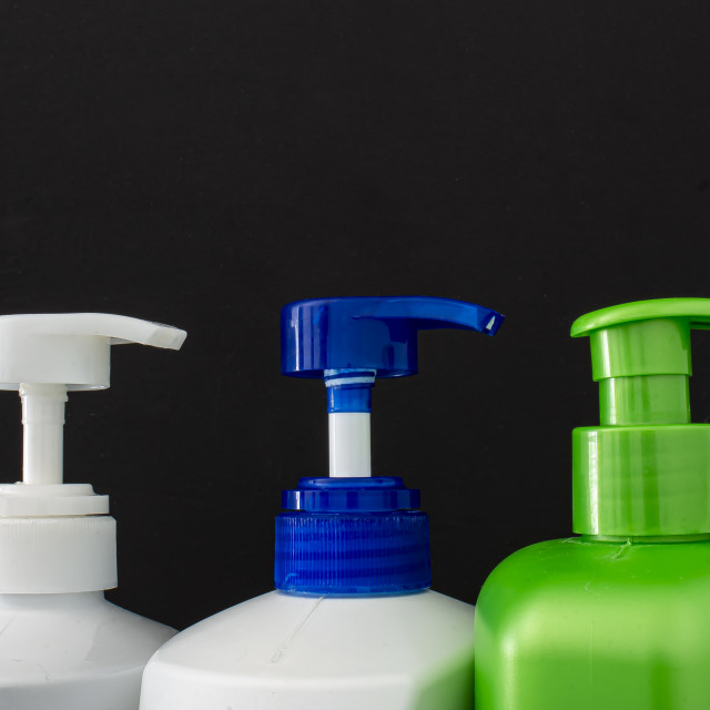 """""""Shampoo colorful bottles top on a black background"""" stock image"""