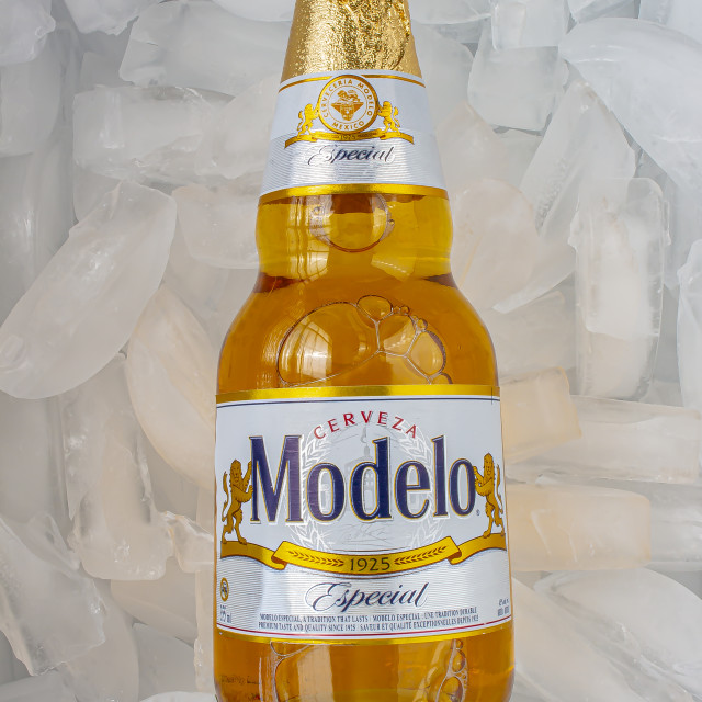 """Modelo Especial beer bottle clear bright yellow colour on ice"" stock image"