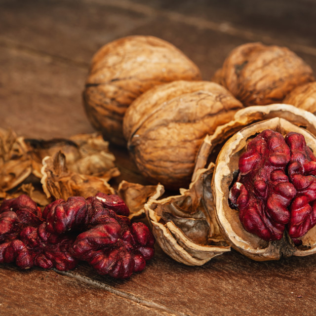 """Red Danube Walnuts on wooden background"" stock image"
