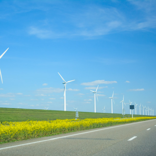 """Wind turbines along the highway in the Netherlands"" stock image"