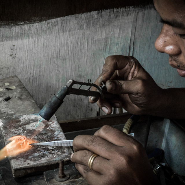 """Faces of Myanmar - A jeweller in Jade Market"" stock image"
