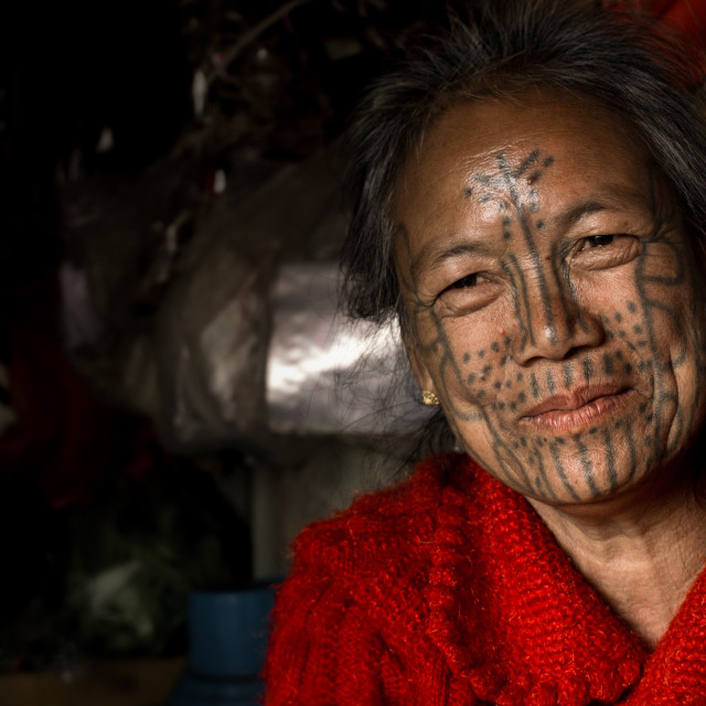 """Faces of MyanmarFaces of Myanmar - Tattooed face woman of Mindat"" stock image"
