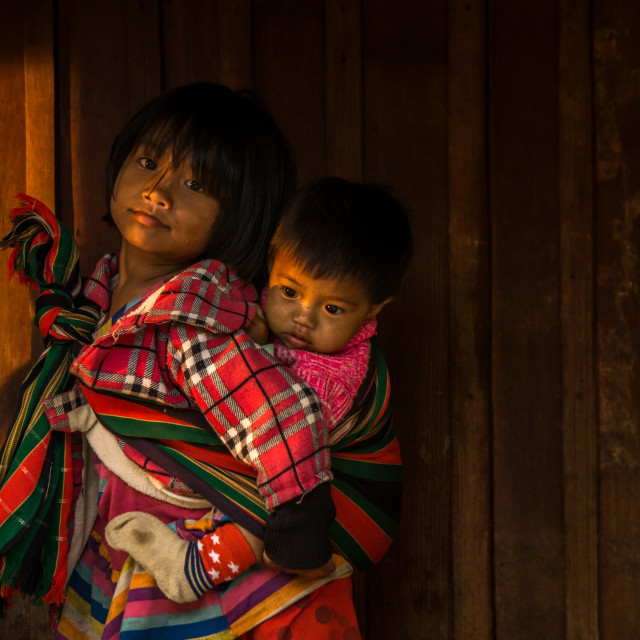 """Faces of Myanmar - Sister and brother"" stock image"