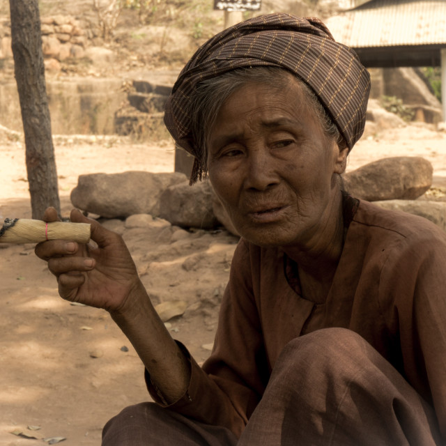 """Faces of Myanmar - Old lady with a Churchillian-sized cheroot"" stock image"