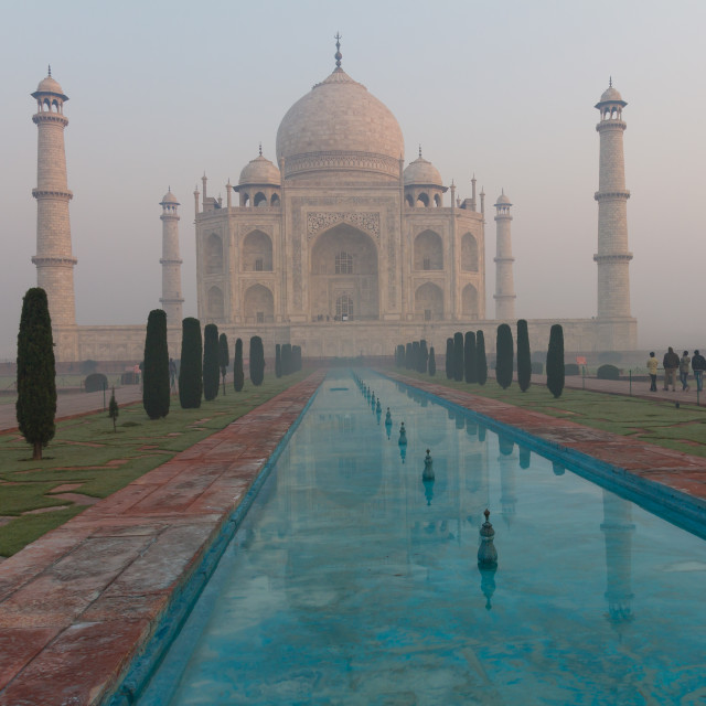 """Taj Mahal waking up from the morning mist"" stock image"