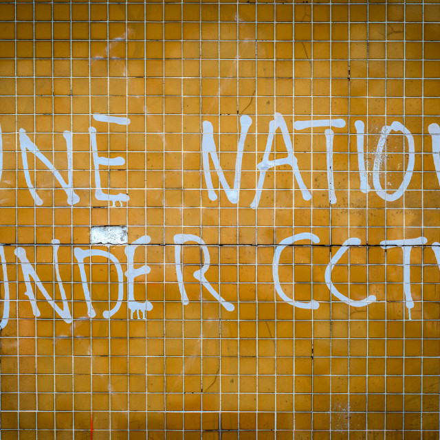 """One Nation Under CCTV Graffiti"" stock image"