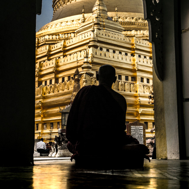 """Meditating in front of the Shwezigon Pagoda"" stock image"