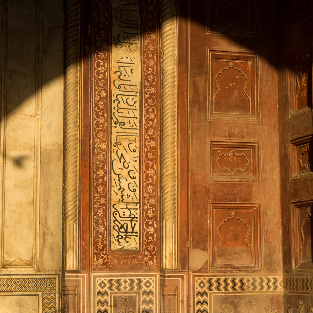 """Interior of the mosque at Taj Mahal lit by the rising sun - details"" stock image"