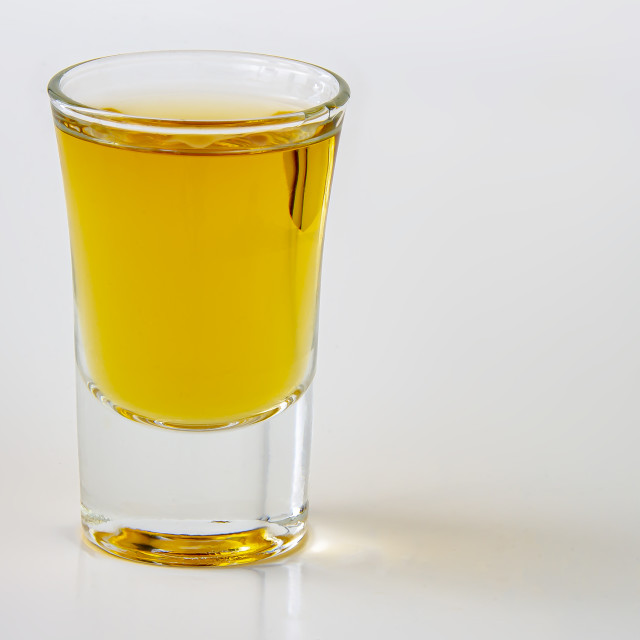 """A horizontal view of a liquor shot drink on a white background"" stock image"