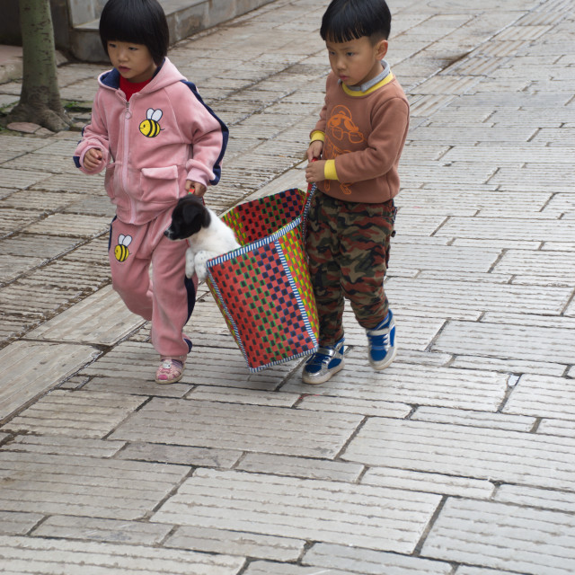 """Two kids at pet market China"" stock image"