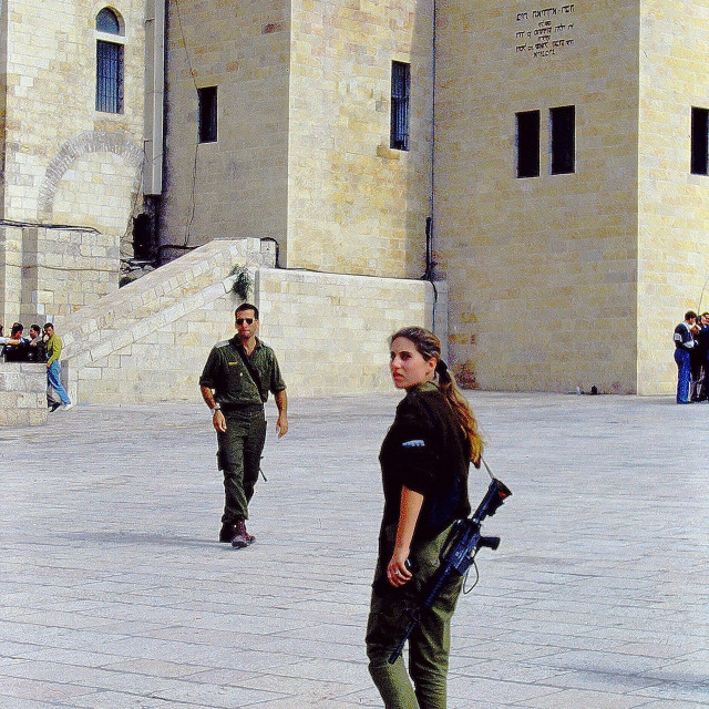 """Wary Israeli soldiers, male & female, petrolling the ancient city of Jerusalem"" stock image"
