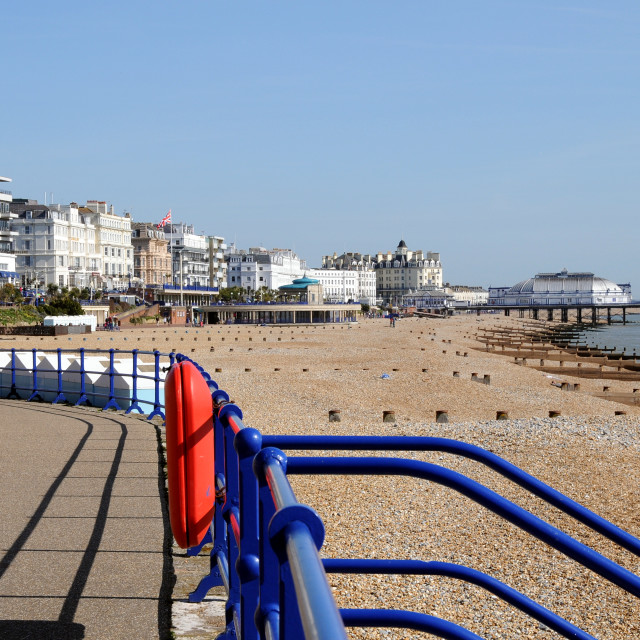 """""""Beach with railings in foreground looking towards pier. ERastbourne, East Sussex, England."""" stock image"""