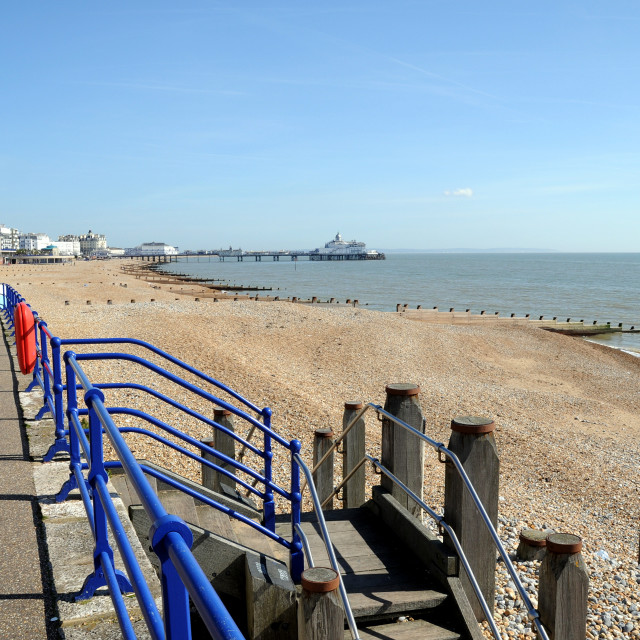 """""""Eastbourne Beach Looking towards The Pier. Image shows steps to the beach."""" stock image"""
