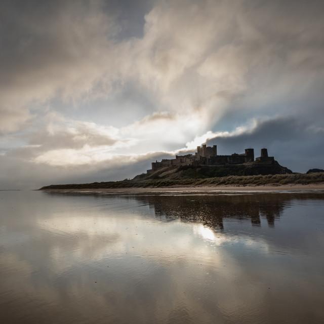 """Bamburgh Castle dramatic light"" stock image"