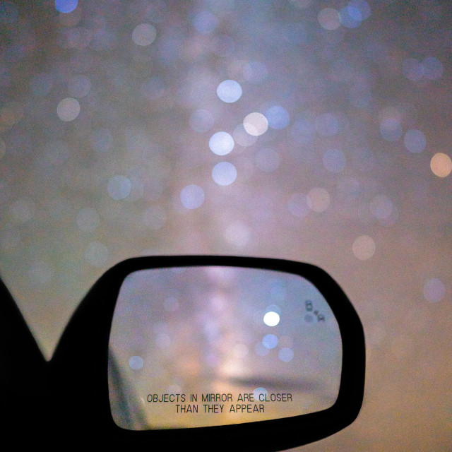 """""""Objects In Mirror Are Closer Than They Appear"""" stock image"""