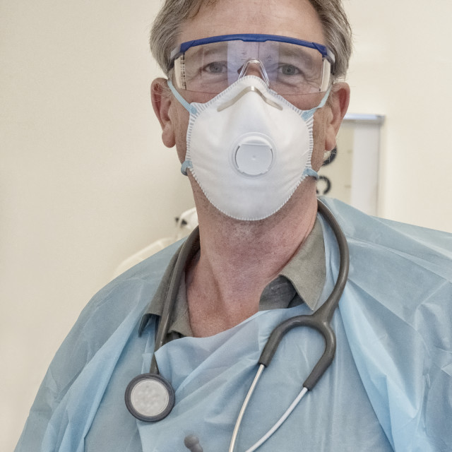 """""""Physician working during Covid-19 outbreak"""" stock image"""